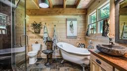 A Rustic Log Home Bathroom, Built for Relaxation